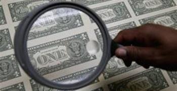 تقرير: الدولار الأمريكي يتراجع بعد بيان مُخيّب لمجلس الاحتياط الفيدرالي